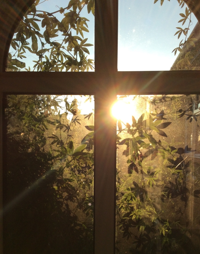Sun shining through cross shaped window