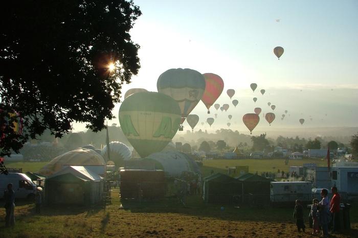 Many balloons on the city skyline