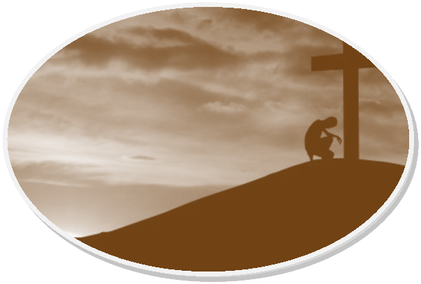 Silhouette of man kneeling before a cross
