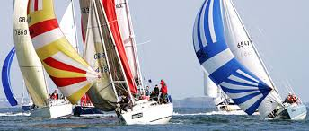 Yachts with coloured spinnakers in full sail